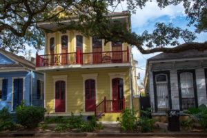 Red and yellow shotgun house in Treme New Orleans, LA