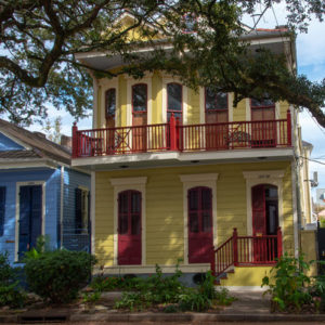 Red and yellow shotgun house in Treme New Orleans