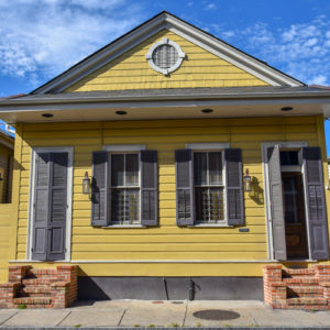 Yellow shotgun house in the French quarter of New Orleans, LA